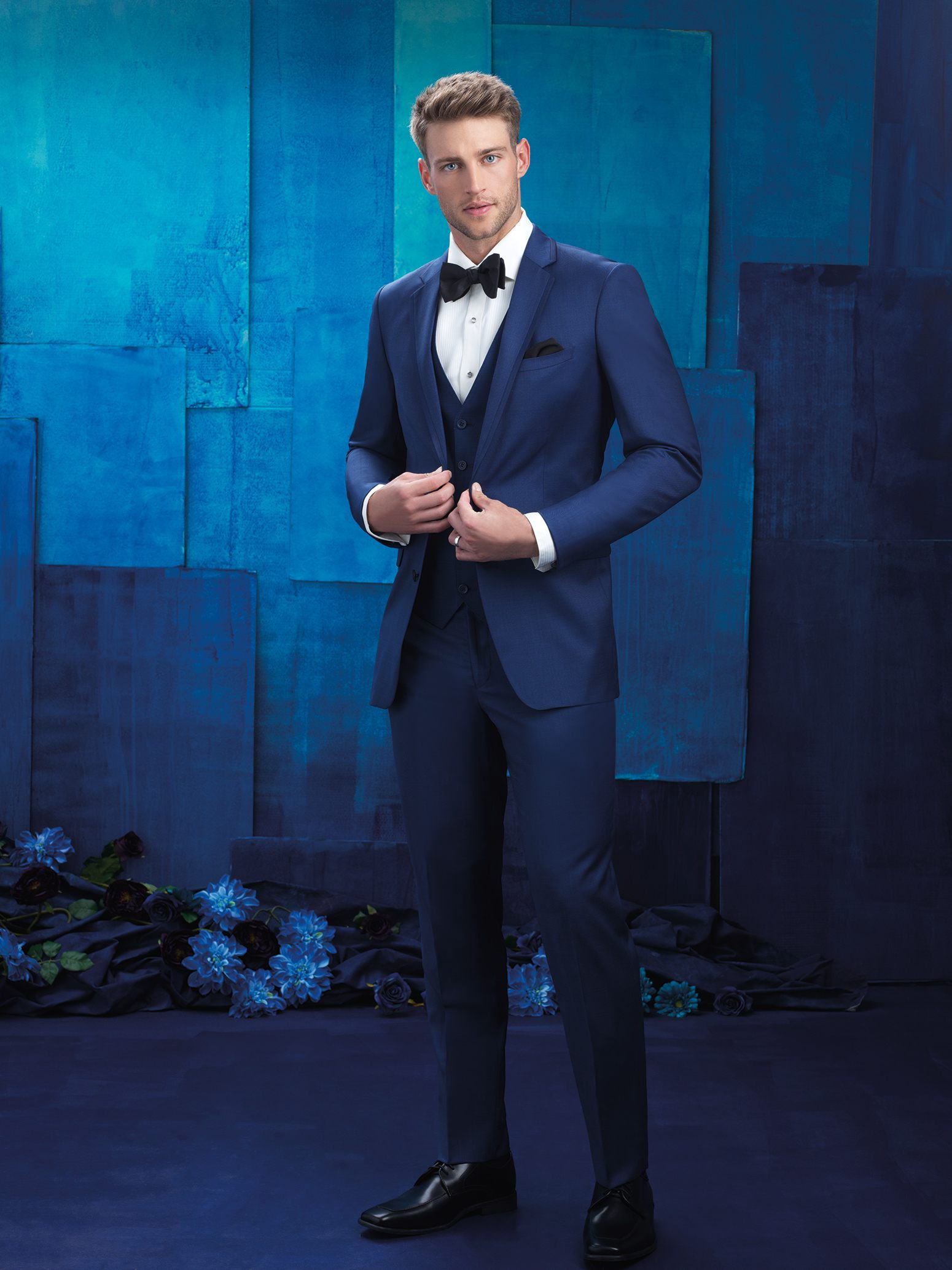 Black suit and blue tie