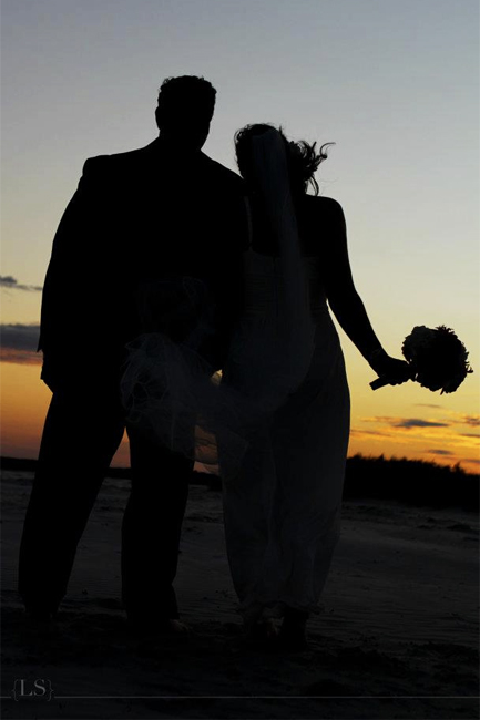 Happy Couple view Sunset at a Fall Destination Wedding