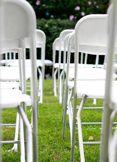 Garden Weddings: White Folding Chairs on Grass