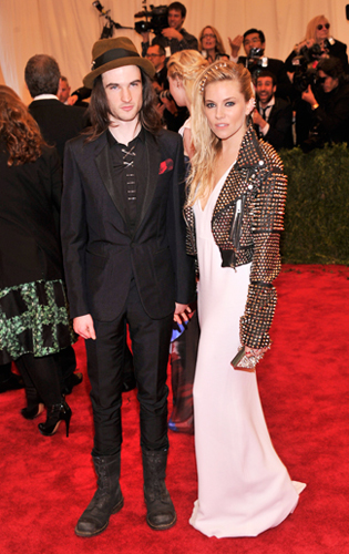 Tom Sturridge in all black tuxedo, boots, and shirt with safety pin closures at the 2013 Met Gala
