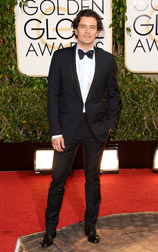 Orlando Bloom in a link-front shawl collar tuxedo