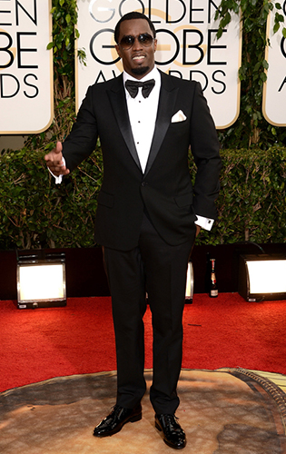 Sean Combs in a one-button peak tuxedo with large bow tie at the Golden Globes!